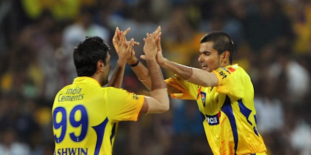 Chennai Super Kings fielder Badrinath (R) celebrates with his teammate after taking a catch to dismiss Kolkata Knight Riders batsman Yousuf Pathan during the IPL Twenty20 cricket final match between Chennai Super Kings (CSK) and Kolkata Knight Riders (KKR) at the M.A. Chidambaram Stadium in Chennai on May 27, 2012.  RESTRICTED TO EDITORIAL USE. MOBILE USE WITHIN NEWS PACKAGE. AFP PHOTO/Manjunath KIRAN        (Photo credit should read Manjunath Kiran/AFP/GettyImages)