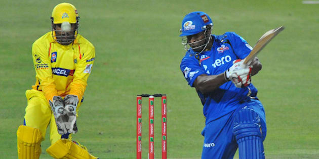 JOHANNESBURG, SOUTH AFRICA - OCTOBER 20: Kieron Pollard of Mumbai hits another six with MS Dhoni of CSK looking on during the Karbonn Smart CLT20 match between Chennai Super Kings and Mumbai Indians at Bidvest Wanderers Stadium on October 20, 2012 in Johannesburg, South Africa. (Photo by Duif du Toit / Gallo Images/Getty Images)