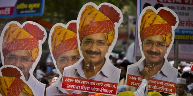 Indian farmers and Aam Aadmi Party or Common man's party supporters display pictures of Delhi Chief Minister leader Arvind Kejriwal at a rally near the Indian parliament in New Delhi, India, Wednesday, April 22, 2015. Indian farmers and the opposition parties are protesting against a government plan to ease rules for obtaining land for industry and development projects. (AP Photo/Saurabh Das)