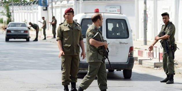 Tunisian soldiers stand guard outside the Bouchoucha army barracks in Tunis on May 25, 2015 after a soldier opened fire at his colleagues. A Tunisian soldier killed some of his comrades and wounded others in a shooting at the barracks near parliament but it was not a 'terrorist' attack, the interior ministry said. AFP PHOTO / FETHI BELAID        (Photo credit should read FETHI BELAID/AFP/Getty Images)