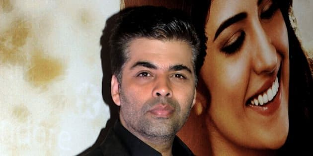 Indian Bollywood film producer and director Karan Johar attends the music launch of the upcoming Hindi film 'Lekar Hum Deewana Dil' written and directed by Arif Ali, in Mumbai on June 12, 2014.   AFP PHOTO        (Photo credit should read STR/AFP/Getty Images)