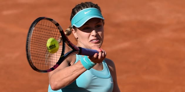 ROME, ITALY - MAY 13:  Eugenie Bouchard of Canada in action against Zarina Diyas of Kasakhstan in their Second Round match on Day Four of The Internazionali BNL d'Italia 2015 at the Foro Italico on May 13, 2015 in Rome, Italy.  (Photo by Mike Hewitt/Getty Images)