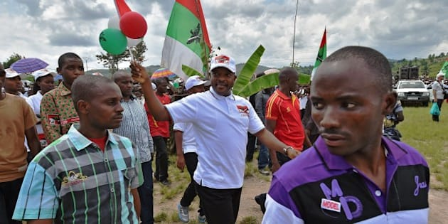 Burundi's President, Pierre Nkurunziza arrives at the rally of his party CNDD-FDD (National Council for the Defense of Democracy, Forces for the Defense of Democracy), outside Bujumbura on May 23, 2015.CNDD-FDD (National Council for the Defense of Democracy, Forces for the Defense of Democracy), during a rally outside Bujumbura on May 23, 2015. Burundian anti-government protesters began a two-day truce after almost a month of deadly violence triggered by the president's bid for a third term, culminating in a grenade attack on civilians in a busy market.  AFP PHOTO / CARL DE SOUZA        (Photo credit should read CARL DE SOUZA/AFP/Getty Images)