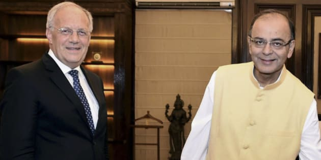 INDIA OUT - Indian Finance Minister Arun Jaitley, right, and Switzerland's Economic Affairs Minister Johann N. Schneider-Ammann arrive for a meeting in New Delhi, India, Friday, May 15, 2015. Schneider-Ammann is on an official visit to the country. (Atul Yadav/Press Trust of India source via AP)