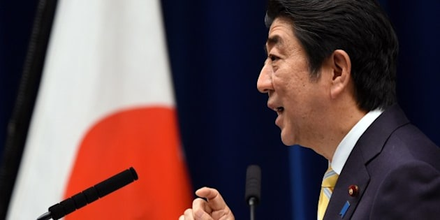 Japan's Prime Minister Shinzo Abe delivers a speech during a press conference following a cabinet meeting which approved a set of bills bolstering the role and scope of the military, at his official residence in Tokyo on May 14, 2015. The bills are a pet project of nationalist Prime Minister Abe, who says Japan can no longer shy away from its responsibility to help safeguard regional stability, and must step out from under the shade of the security umbrella provided by the United States.       AFP PHOTO / TOSHIFUMI KITAMURA        (Photo credit should read TOSHIFUMI KITAMURA/AFP/Getty Images)