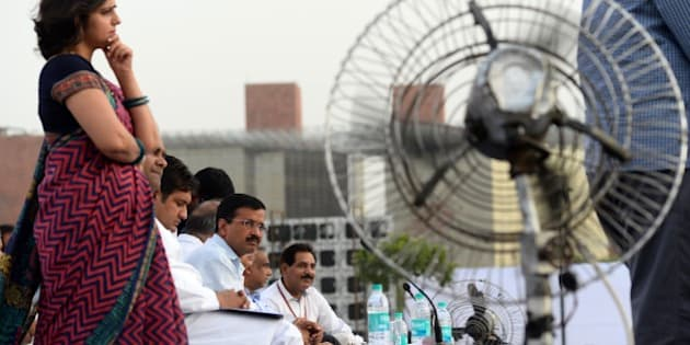 Chief Minister of India's capital New Delhi Arvind Kejriwal (3L) looks on during a public cabinet meeting in Central Park at Connaught Place in New Delhi on May 25,2015, after completing 100 days in office.  AFP PHOTO/SAJJAD HUSSAIN        (Photo credit should read SAJJAD HUSSAIN/AFP/Getty Images)