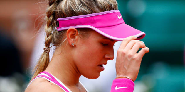 PARIS, FRANCE - MAY 26:  Eugenie Bouchard of Canada reacts during her women's singles match against Kristina Mladenovic of France on day three of the 2015 French Open at Roland Garros on May 26, 2015 in Paris, France.  (Photo by Julian Finney/Getty Images)