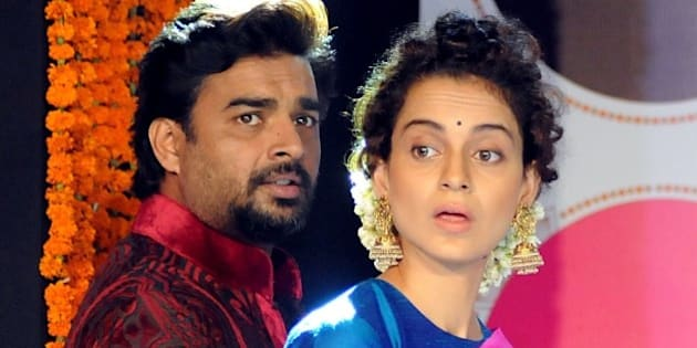 Indian Bollywood actors Kangana Ranaut (L) and R. Madhavan attend a party for the Hindi film Tanu Weds Manu Returns in Mumbai late on May 16, 2015.   AFP PHOTO        (Photo credit should read STR/AFP/Getty Images)