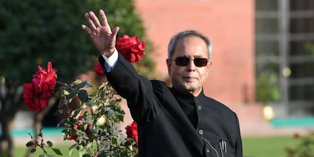 Indian President Pranab Mukherjee gestures to media during a photocall at The Mughal Garden at the Presidential Palace in New Delhi on February 13, 2015. The 15-acre area of the Mughal Gardens of Rashtrapati Bhawan was designed by Sir Edwin Lutyens and have been opened for the annual public viewing from February 14-March 15.  AFP PHOTO/ PRAKASH SINGH        (Photo credit should read PRAKASH SINGH/AFP/Getty Images)