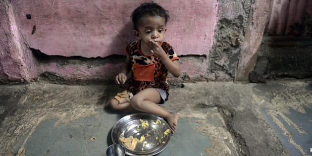 A malnourished Indian child finishes her lunch consisting of a special supplementary diet at the Nutrition Rehabilitation Centre (NRC) of Apnalaya - an Indian NGO providing nutritious free meals to children of manual scavengers and labourers from nearby slums at Govandi on the outskirts of Mumbai on April 18, 2013. India's parliament has passed a flagship 18-billion-dollar programme to provide subsidised food to the poor that is intended to 'wipe out' endemic hunger and malnutrition in the aspiring superpower. The Food Security Bill -- a key scheme seen as a vote-winner by the ruling Congress party ahead of national elections next year -- was adopted in the lower house after a nine-hour debate. AFP PHOTO/ INDRANIL MUKHERJEE        (Photo credit should read INDRANIL MUKHERJEE/AFP/Getty Images)