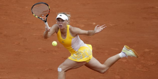 Denmark's Caroline Wozniacki  returns the ball to Germany's Julia Goerges during their second round match of the French Open tennis tournament at the Roland Garros stadium, Thursday, May 28, 2015 in Paris. Georges won 6-4, 7-6.  (AP Photo/Christophe Ena)