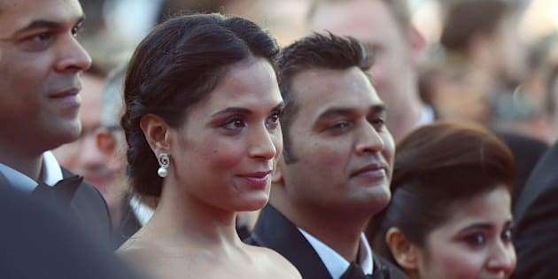 Indian producer Vikramaditya Motwane (L), Indian actress Richa Chadda (2ndL), Indian producer Manish Mundra and Indian actress Shweta Tripathi pose as they arrive for the screening of the film 'Masaan' at the 68th Cannes Film Festival in Cannes, southeastern France, on May 19, 2015. AFP PHOTO / ANNE-CHRISTINE POUJOULAT        (Photo credit should read ANNE-CHRISTINE POUJOULAT/AFP/Getty Images)