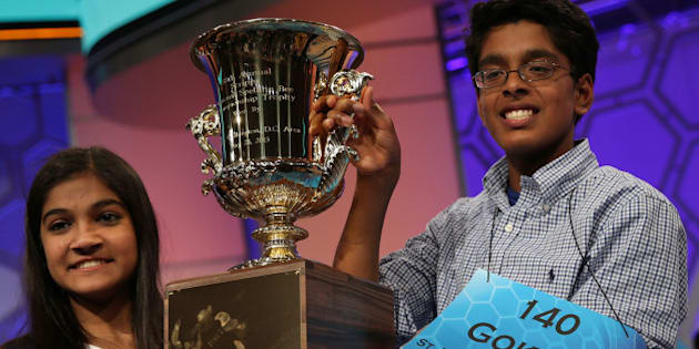 NATIONAL HARBOR, MD - MAY 28  Speller Vanya Shivashankar  (L) of Olathe, Kansas, and speller Gokul Venkatachalam (R) of St. Louis, Missouri, hold up the trophy after winning the 2015 Scripps National Spelling Bee May 28, 2015 in National Harbor, Maryland. Shivashankar and Venkatachalam were declared co-champion at the annual spelling competition.  (Photo by Alex Wong/Getty Images)
