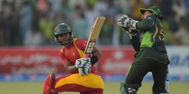 Zimbabwe batsman Chamu Chibhabha (L) is caught behind by Pakistani wicketkeeper Sarfraz Ahmed for 99 runs during the second one day international match between Pakistan and Zimbabwe at the Gaddafi Cricket Stadium in Lahore on May 29, 2015. AFP PHOTO / AAMIR QURESHI        (Photo credit should read AAMIR QURESHI/AFP/Getty Images)