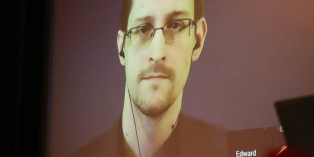 BERLIN, GERMANY - DECEMBER 14:  Former National Security Agency (NSA) contractor turned whistleblower Edward Snowden speaks during a video conference at an award ceremony for the Carl von Ossietzky journalism prize on December 14, 2014 in Berlin, Germany. Filmmaker Laura Poitras, Snowden and journalist Glenn Greenwald (the latter two in absentia) were awarded the prize by the International League for Human Rights for having 'put their personal freedom on the line to expose abuse of power' by Germany and the United States in their revelations of the extent of government surveillance on ordinary citizens in the name of 'national security' in the wake of terrorist attacks. The prize is named for journalist and Nobel Peace Prize winner Ossietzky, who died from complications from being held as a dissident in a Nazi concentration camp. A bid to allow Snowden, who has temporary asylum in Moscow, to testify in Berlin before an NSA parliamentary inquiry is ongoing.  (Photo by Adam Berry/Getty Images)
