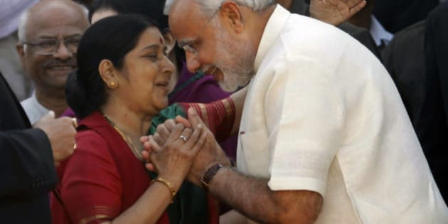 India's main opposition Bharatiya Janata Party (BJP) leaders, Narendra Modi, right, and Sushma Swaraj greet each other before his oath taking ceremony, in Ahmadabad, India, Wednesday, Dec. 26, 2012. Hindu nationalist leader Narendra Modi won a resounding victory in state elections was sworn in Wednesday for a fourth term as chief minister in the western Indian state of Gujarat. (AP Photo/Ajit Solanki)