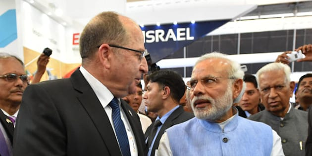 BANGALORE, INDIA - FEBRUARY 18:   (ISRAEL OUT) In this handout provided by the Israeli Ministry of Defence,  Israeli Defense Minister Moshe Ya'alon visits the arms exhibition in India with Indian Prime Minister Narendra Modi at Aero India 2015 on February 18, 2015 in Bangalore, India.  Defense Minister Moshe Ya'alon is in India, marking the first state visit by an Israeli defense minister to that nation.  (Photo by Ariel Hermoni-Levine /Israeli Ministry of Defense via Getty Images)