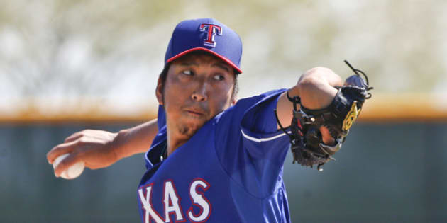 Texas Rangers pitcher Kyuji Fujikawa  pitches in an intrasquad game prior to a spring training baseball game against the Seattle Mariners Friday, March 20, 2015, in Surprise, Ariz.  (AP Photo/Lenny Ignelzi)