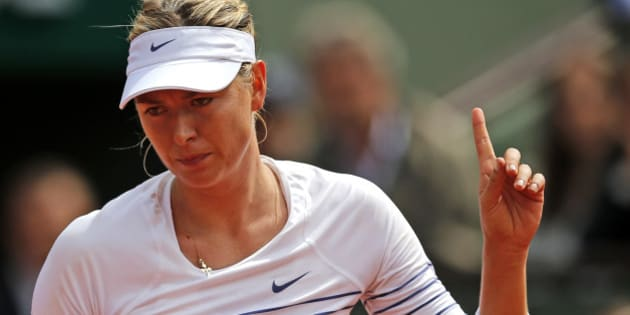 Russia's Maria Sharapova reacts as she plays Lucie Safarova of the Czech Republic during their fourth round match of the French Open tennis tournament at the Roland Garros stadium, Monday, June 1, 2015 in Paris, France. (AP Photo/Christophe Ena)