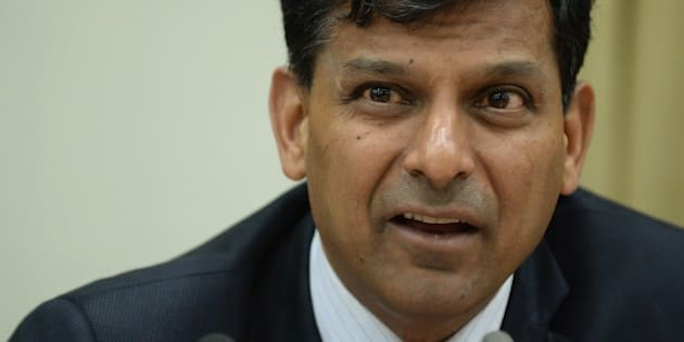 Reserve Bank of India (RBI) governor Raghuram Rajan speaks during a news conference at the RBI headquarters in Mumbai on December 2, 2014. India's central bank kept interest rates unchanged on December 2 despite growing calls to ease monetary policy, saying a reduction would be 'premature'.  AFP PHOTO/ PUNIT PARANJPE        (Photo credit should read PUNIT PARANJPE/AFP/Getty Images)