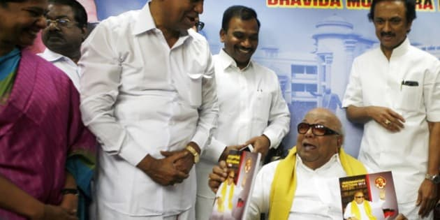 Leader of the Dravida Munnetra Kazhagam party M. Karunanidhi, seated, releases his party's election manifesto for the upcoming elections, surrounded by party leaders, from right, M.K. Stalin, Andimuthu Raja, T.R. Balu and Kanimozhi, in Chennai, India, Tuesday, March 11, 2014. India will hold national elections from April 7 to May 12, kicking off a vote that many observers see as the most important election in more than 30 years in the world's largest democracy. (AP Photo/Arun Sankar K.)
