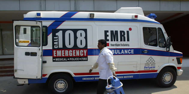 An Indian medical technician walks past an Emergency Management and Research Institute (EMRI) ambulance in Hyderabad,on February 18, 2009. EMRI is the only professional Emergency provider in India, as a non profitable organization operating in the Public Private Partnership(PPP) mode. EMRI provides a comprehensive emergency mangement service in the states of Andhra Pradesh, Gujarat, Uttarakhand, Goa, Chennai, Rajasthan, Karnataka and Assam using a single toll-free number 108.The Number 108 is used as the centralized helpline for Medical,Police and Fire emergency situations involving individuals. AFP PHOTO/Noah SEELAM (Photo credit should read NOAH SEELAM/AFP/Getty Images)
