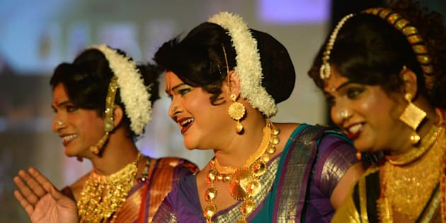 Indian transgenders perform at a seminar for the transgender community in Mumbai on October 3, 2013. For India's gay community, the joy that greeted year 2009 court ruling legalising gay sex is tempered by the fact that, although the law now accepts them, society still does not. For all the celebrations and talk of an historic milestone, many believe it will take more than a court decision to change public attitudes toward homosexuality, which is largely taboo in India and considered by many to be a mental illness.    AFP PHOTO/ PUNIT PARANJPE        (Photo credit should read PUNIT PARANJPE/AFP/Getty Images)