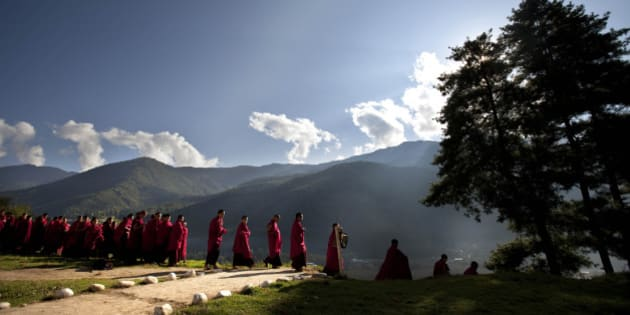 Bhutanese novice Buddhist monks walk to breakfast at a monastery in the capital of Thimphu, Bhutan, Wednesday, Oct. 12, 2011. King Jigme Khesar Namgyal Wangchuck and future Queen Jetsun Pema will wed in the small Himalayan Kingdom in a series ceremonies set for Thursday.(AP Photo/Kevin Frayer)
