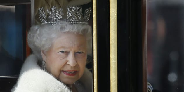 Britain's Queen Elizabeth II travels in a carriage from Buckingham Palace towards the Houses of Parliament in London, Wednesday, May 27, 2015. The Queen will deliver a speech to open Britain's Parliament after the new Conservative government was elected. (AP Photo/Kirsty Wigglesworth)