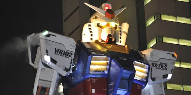 An 18-metre tall statue of popular TV animation hero Gundam is lit up at a park in Shizuoka city, 150km west of Tokyo on July 6, 2010 for a press preview. The huge statue of the life sized robot, which attracted over 3 million spectators in Tokyo last year, will be displayed for the commemoration of the 30th anniversary of the establishment of the Gundam plastic models. The statue will be opened to the public from July 24 through the early next year. AFP PHOTO/YOSHIKAZU TSUNO (Photo credit should read YOSHIKAZU TSUNO/AFP/Getty Images)