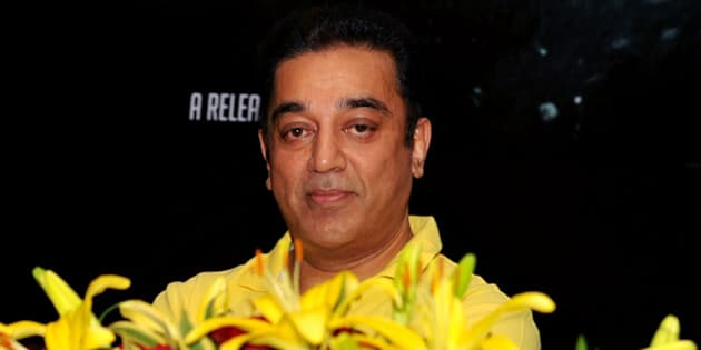 "Indian Bollywood actor Kamal Haasan gestures during the promotion of the forthcoming dual language Tamil and Hindi film ""Vishwaroopam"" at a press conference in Mumbai on December 18, 2012.  AFP PHOTO/STR        (Photo credit should read STRDEL/AFP/Getty Images)"