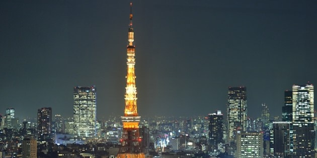 This picture taken on December 3, 2013 shows Tokyo Tower illuminated at night in Tokyo. The 333-metre-high communications and observation tower is the second-tallest artificial structure in Japan. AFP PHOTO / KAZUHIRO NOGI        (Photo credit should read KAZUHIRO NOGI/AFP/Getty Images)