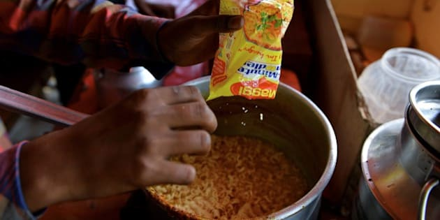 An Indian youth prepares Nestle 'Maggi' instant noodles at his makeshift roadside food stall on the outskirts of New Delhi on June 3, 2015. India June 3, 2015, tested packets nationwide of Nestle India's instant noodles after high lead levels were found in batches in the country's north amid a mounting food-safety scare, an official said.  AFP PHOTO / Chandan KHANNA        (Photo credit should read Chandan Khanna/AFP/Getty Images)