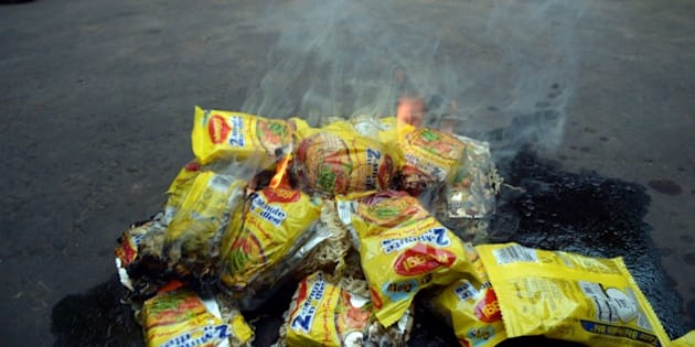 Indian social activists burn packets of Nestle's Maggi instant noodles during a protest in Kolkata on June 4, 2013.  The food and consumer affairs ministry said June 3 that it was concerned over reports that the popular two-minute noodles contained high levels of lead, which can cause hypertension, harm the kidneys and in extreme cases lead to death as the government said it was testing samples from across the country to check if they contained lead in excess.   AFP PHOTO/ Dibyangshu Sarkar        (Photo credit should read DIBYANGSHU SARKAR/AFP/Getty Images)