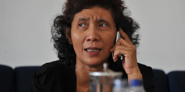 The owner of Indonesian scheduled and charter airline Susi Air, Susi Pudjiastuti, speaks over the phone in Pangandaran, West Java, on September 10, 2011. A Susi Air Cessna Grand Caravan aircraft with one Australian and one Slovak pilot on board crashed in the country's remote Papua region, a company spokesman said, with both men feared dead. AFP PHOTO / Bay ISMOYO (Photo credit should read BAY ISMOYO/AFP/Getty Images)