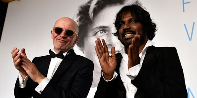 CANNES, FRANCE - MAY 24:  (L-R) Director Jacques Audiard and actor Jesuthasan Antonythasan clap after winning the Palme d'Or won for 'Dheepan' during the Palme D'Or Winners press conference during the 68th annual Cannes Film Festival on May 24, 2015 in Cannes, France.  (Photo by Pool/Getty Images)