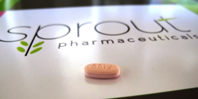 FILE - In this Friday, Sept. 27, 2013, file photo, a tablet of flibanserin sits on a brochure for Sprout Pharmaceuticals in the company's Raleigh, N.C., headquarters. The pill has been twice rejected, but Sprout Pharmaceuticals said Tuesday, Feb. 17, 2015, it is refiling its application for flibanserin, adding new information requested by the Food and Drug Administration about how the pill affects driving ability. (AP Photo/Allen G. Breed, File)