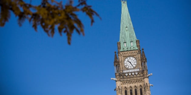 OTTAWA, ON - OCTOBER 23:  The flag atop the Main Parliament Building is flown at half staff one day after Cpl. Nathan Cirillo of the Canadian Army Reserves was killed while standing guard in front of the National War Memorial by a lone gunman, on October 23, 2014 in Ottawa, Canada. After killing Cirillo the gunman stormed the main parliament building, terrorizing the public and politicians, before he was shot dead.  (Photo by Andrew Burton/Getty Images)