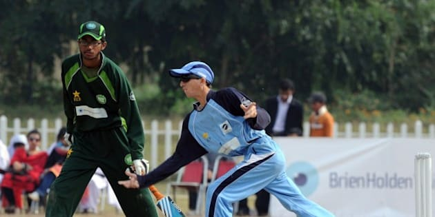 Visually impaired Indian cricketer Ketan Patel (R) bowls during the first one-day international cricket match between Pakistan and India blind cricket teams in Islamabad on November 22, 2011. India and Pakistan resumed cricketing ties November 22 after three years -- albeit at a low level -- by fielding their blind teams for an international series. Pakistan has hosted no major international matches over security fears posed by Al-Qaeda and the Taliban since 2009, and India stalled direct cricketing ties after Islamist gunmen killed 166 people in Mumbai in late 2008. AFP PHOTO / AAMIR QURESHI (Photo credit should read AAMIR QURESHI/AFP/Getty Images)