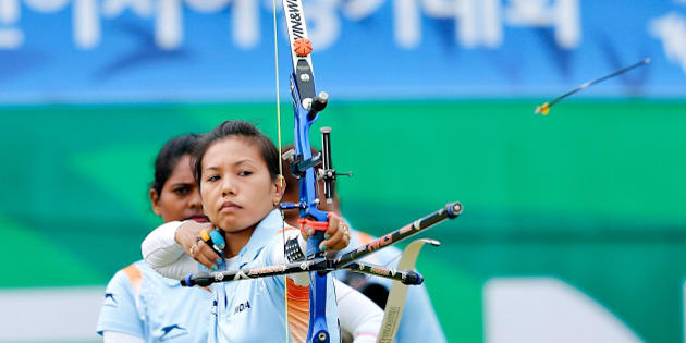 INCHEON, SOUTH KOREA - SEPTEMBER 28: Laishram Bombayla Devi of India competes in the Archery Recurve Women's Team Bronze Medal Match in day nine during the 2014 Asian Games at Gyeyang Asiad Archery Field on September 28, 2014 in Incheon, South Korea.  (Photo by Lintao Zhang/Getty Images)