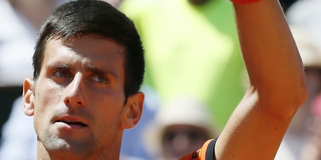 Serbia's Novak Djokovic celebrates his victory over Great Britain's Andy Murray during their men's semi-final match of the Roland Garros 2015 French Tennis Open in Paris on June 6, 2015. AFP PHOTO / PATRICK KOVARIK        (Photo credit should read PATRICK KOVARIK/AFP/Getty Images)