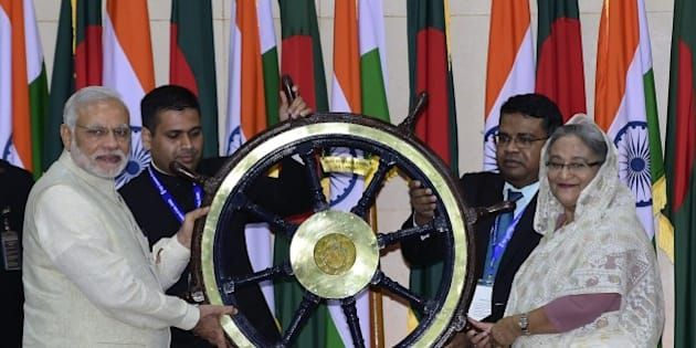 Indian Prime Minister Narendra Modi (L) hands over the steering wheel of INS Vikrant to Sheikh Hasina Wajid (R) at the Prime Minister's Office in Dhaka on June 6, 2015. Bangladesh and India on June 6 sealed a historic land pact to swap territories, which will finally allow tens of thousands of people living in border enclaves to choose their nationality after decades of stateless limbo. AFP PHOTO/ Munir uz ZAMAN        (Photo credit should read MUNIR UZ ZAMAN/AFP/Getty Images)
