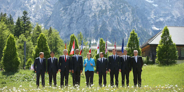 GARMISCH-PARTENKIRCHEN, GERMANY - JUNE 07:  (From L to R) President of the European Council Donald Tusk, Japanese Prime Minister Shinzo Abe, Canada's Prime Minister Stephen Harper, U.S. President Barack Obama, German Chancellor Angela Merkel, French President Francois Hollande, British Prime Minister David Cameron, Italian Prime Minister Matteo Renzi and President of the European Commission Jean-Claude Juncker pose at the group photo at the summit of G7 nations at Schloss Elmau on June 7, 2015 near Garmisch-Partenkirchen, Germany. In the course of the two-day summit G7 leaders are scheduled to discuss global economic and security issues, as well as pressing global health-related issues, including antibiotics-resistant bacteria and Ebola. Several thousand protesters have announced they will seek to march towards Schloss Elmau and at least 17,000 police are on hand to provide security.  (Photo by Sean Gallup/Getty Images)