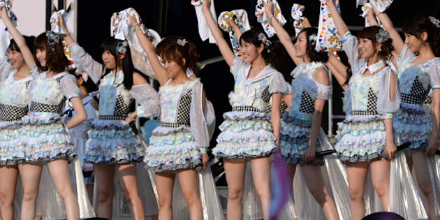 Japanese girl pop group AKB48, (L-R) Rena Matsui, Haruka Shimazaki, Rino Sashihara, Minami Takahashi, Mayu Watanabe, Jurina Matsui, Yuko Oshima and Yuki Kashiwagi perform during their concert at the Yokohama stadium in Yokohama, south of Tokyo on June 8, 2013. Over 70,000 spectators gathered for the concert as well as the election results announcing the upcoming recording members selection.    AFP PHOTO / TOSHIFUMI KITAMURA        (Photo credit should read TOSHIFUMI KITAMURA/AFP/Getty Images)