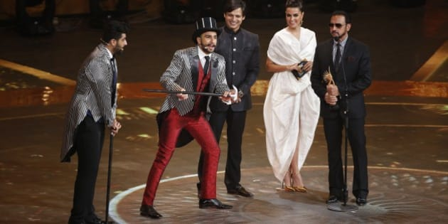 Bollywood actor Ranveer Singh, second left, entertains the audience at the International Indian Film Academy (IIFA) awards in Kuala Lumpur, Malaysia, Sunday, June 7, 2015. The three day event concludes Sunday. (AP Photo/Joshua Paul)