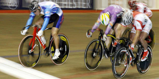 MANCHESTER, United Kingdom: Japan's Kazuya Narita (L) wins heat 4 of the Mens keirin race from Poland's Pawel Kosciecha (R) at the UCI World Cup Classics cycling event at the Manchester Velodrome, north-west England, 23 February 2007. AFP PHOTO/ANDREW YATES (Photo credit should read ANDREW YATES/AFP/Getty Images)