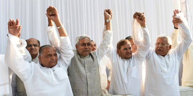 (L-R)  Samajwadi Party chief Mulayam Singh Yadav, Nitish Kumar, chief minister of Bihar, Sharad Yadav of the Janata Dal (United) party, Lalu Prasad Yadav of Rashtriya Janata Dal party pose for photographers ahead of a press conference in New Delhi on April 15, 2015.  Six Indian left-leaning and regional political parties vowed to work together to take on Prime Minister Narendra Modi's right-wing Bharatiya Janata Party ahead of key Bihar state elections scheduled later in the year.  AFP PHOTO / SAJJAD HUSSAIN        (Photo credit should read SAJJAD HUSSAIN/AFP/Getty Images)