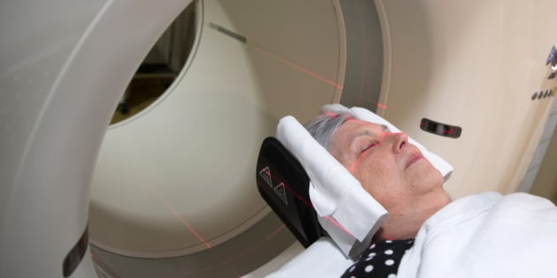 In this photo taken May 19, 2015, Judith Chase Gilbert, of Arlington, Va., is loaded into a PET scanner at Georgetown University Hospital in Washington. Gilbert shows no signs of memory problems but volunteered for a new kind of scan as part of a study peeking into healthy brains to check for clues about Alzheimer's disease.  (AP Photo/Evan Vucci)