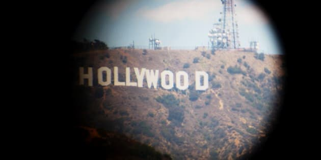 Hollywood sign taken from a tourist viewing scope or whatever.