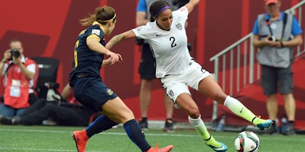 Forward Sydney Leroux of the USA (R) vies for the ball with Australian defender Servet Uzunlar during the Group D match of the 2015 FIFA Women's World Cup between the USA and Australia at the Winnipeg Stadium on June 8, 2015, in Winnipeg, Manitoba. AFP PHOTO/JEWEL SAMAD        (Photo credit should read JEWEL SAMAD/AFP/Getty Images)